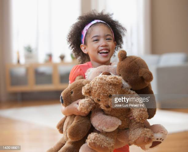 mixed race girl holding teddy bears - stuffed toy stock pictures, royalty-free photos & images