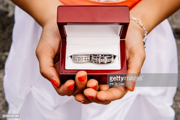mixed race girl holding wedding rings - ring bearer stock pictures, royalty-free photos & images
