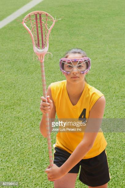 Mixed race girl in lacrosse uniform