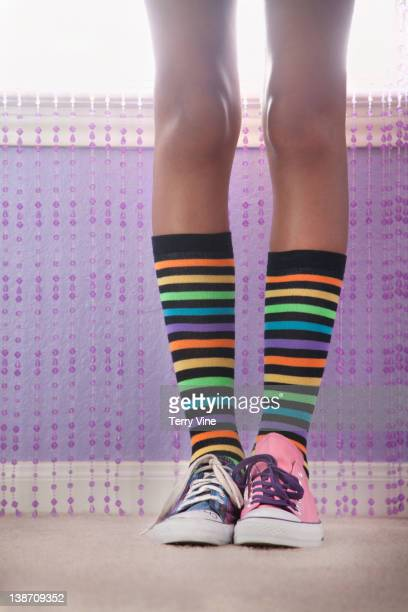 mixed race girl in mismatched shoes - mismatch stock pictures, royalty-free photos & images