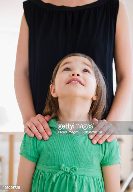 Mixed race girl looking at mother