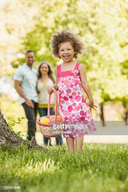 Mixed race girl on Easter egg hunt