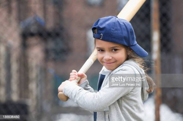 mixed race girl playing baseball - termine sportivo foto e immagini stock