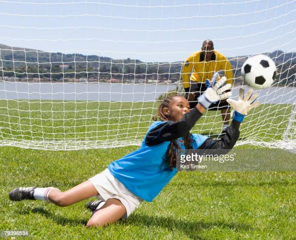 mixed race girl playing soccer - goalie goalkeeper football soccer keeper stock pictures, royalty-free photos & images