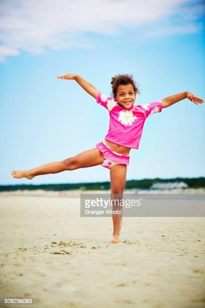 Mixed race girl posing on beach