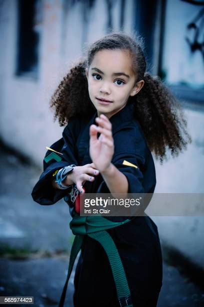 mixed race girl practicing martial arts - girl fight stock photos and pictures
