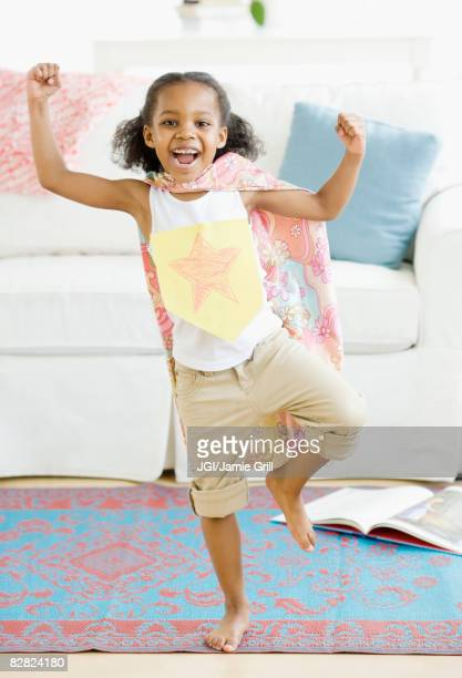 mixed race girl pretending to be superhero - cape garment stock photos and pictures