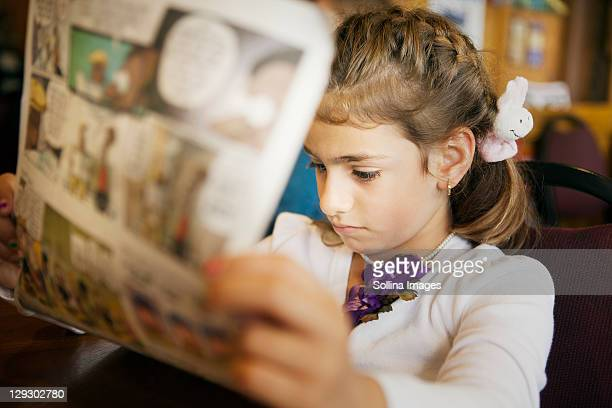 mixed race girl reading newspaper - animation stock pictures, royalty-free photos & images