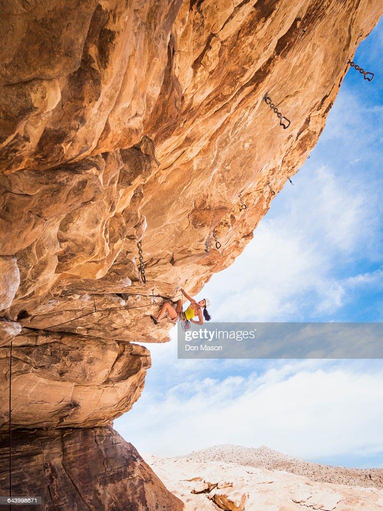 Female Rock Climbing At Railay Beach Krabi Thailand High