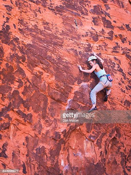 mixed race girl rock climbing on cliff - las vegas girls stock photos and pictures