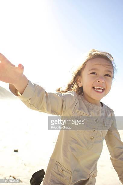 Mixed race girl, running outdoors