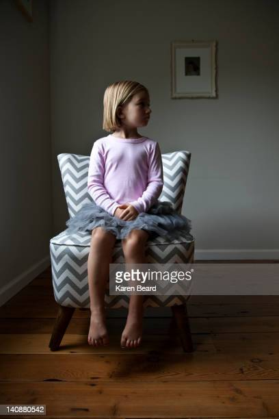 mixed race girl sitting on chair - innocence stock pictures, royalty-free photos & images