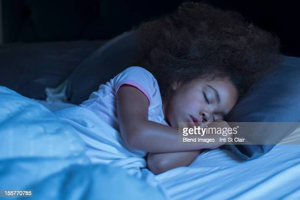 Mixed race girl sleeping