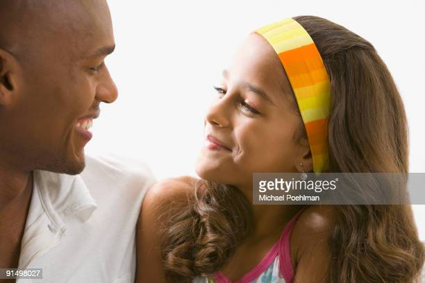 Mixed race girl smiling at father