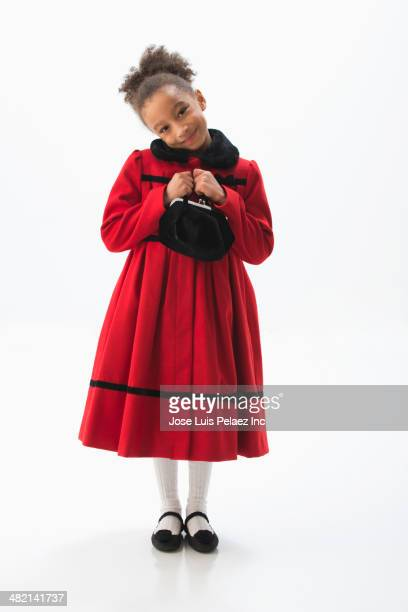mixed race girl smiling in dress coat - frock coat stock pictures, royalty-free photos & images