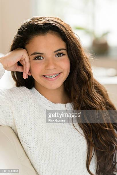 Mixed race girl smiling on sofa
