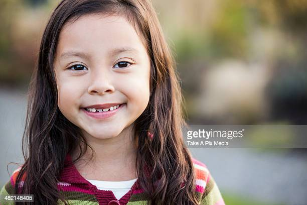 Mixed race girl smiling outdoors