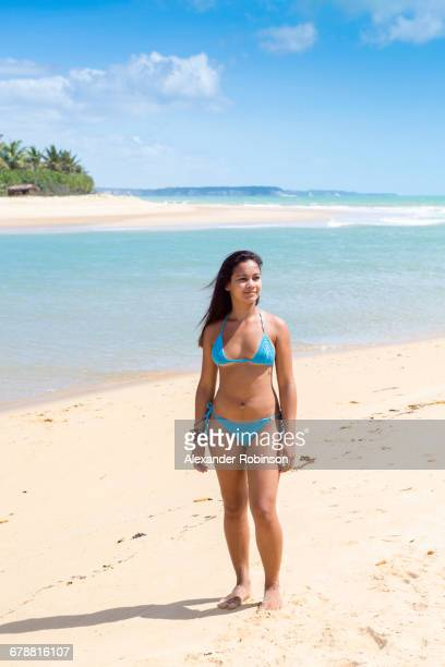 mixed race girl standing on beach - brazilian girls stock photos and pictures