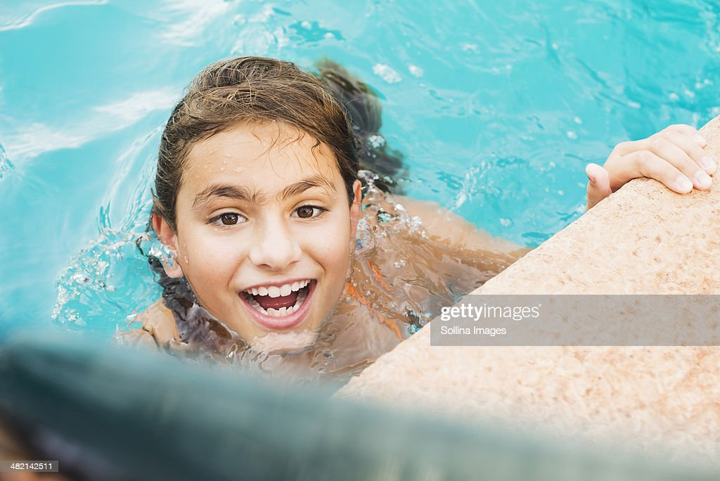 bd7ee2cbc2d Mixed race girl swimming in pool   Stock Photo