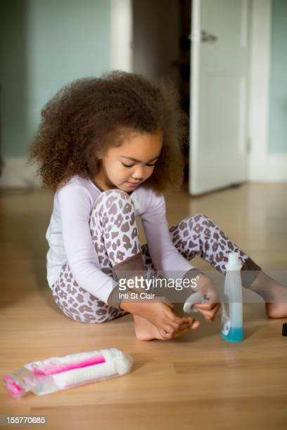 mixed race girl using polish remover - girl strips stock pictures, royalty-free photos & images
