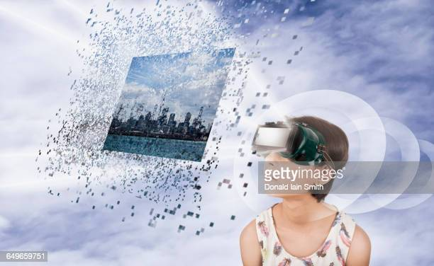 Mixed race girl watching virtual reality screen