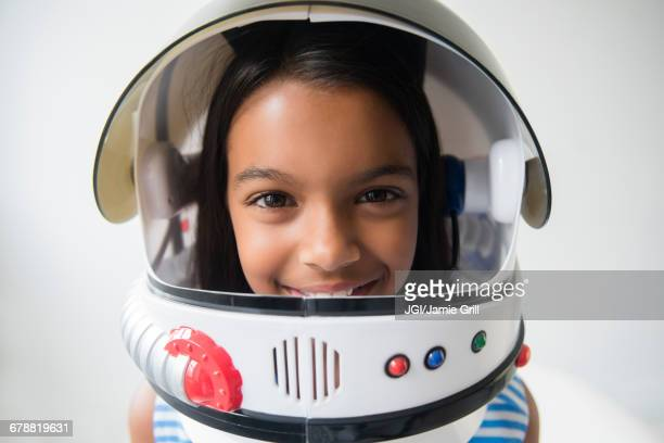 mixed race girl wearing astronaut helmet - space helmet stock pictures, royalty-free photos & images