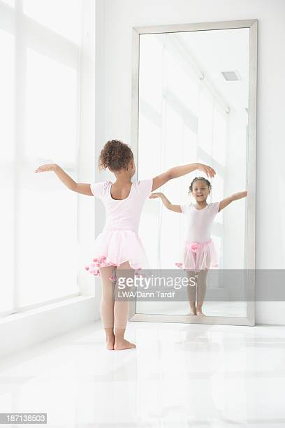 Mixed race girl wearing ballerina costume