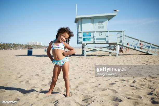 Mixed race girl wearing bikini on beach