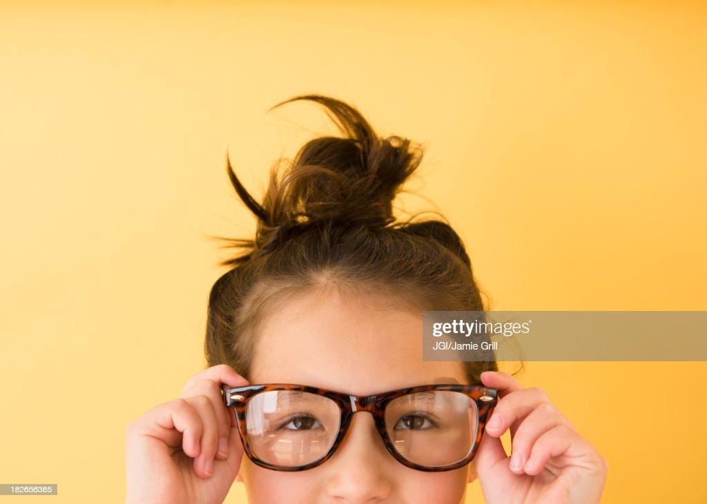 Mixed race girl wearing glasses : Stock Photo