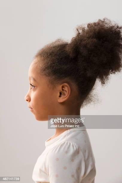 Mixed race girl wearing hair in bun