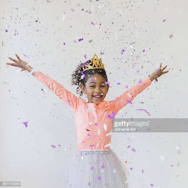 mixed race girl wearing tiara throwing confetti - princess stock pictures, royalty-free photos & images