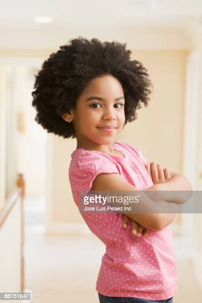 Mixed race girl with arms crossed