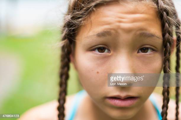 Mixed race girl with braids