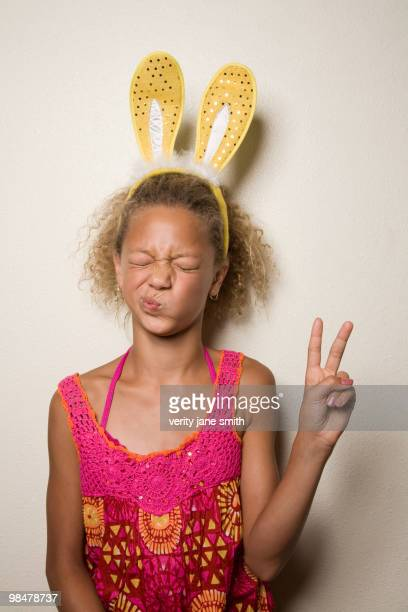 Mixed race girl with bunny ears