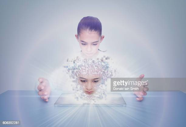 Mixed race girl with digital projection of face