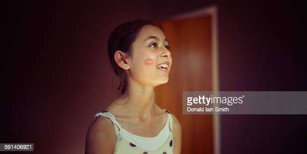 mixed race girl with lipstick kiss on cheek - indian girl kissing stock photos and pictures