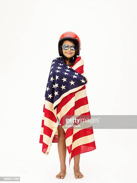 Mixed race girl wrapped in American flag