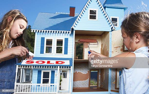 mixed race girls fixing up doll house for sale - dollhouse stock pictures, royalty-free photos & images