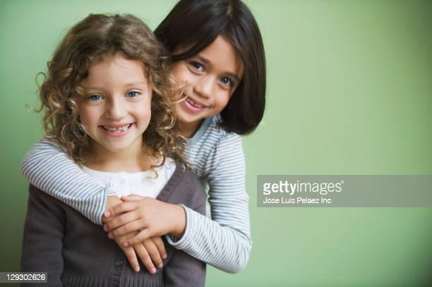 Mixed race girls hugging