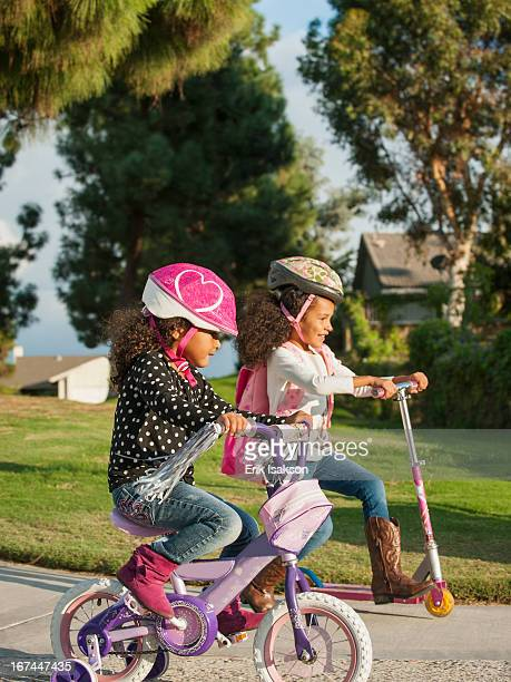 Mixed race girls playing outdoors