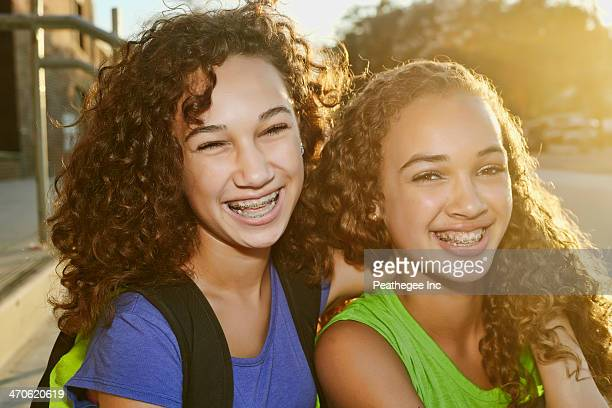 Mixed race girls smiling