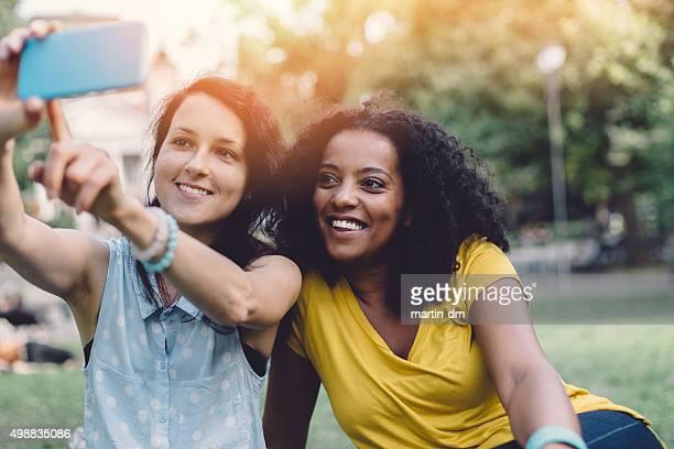 Mixed race girls taking a selfie