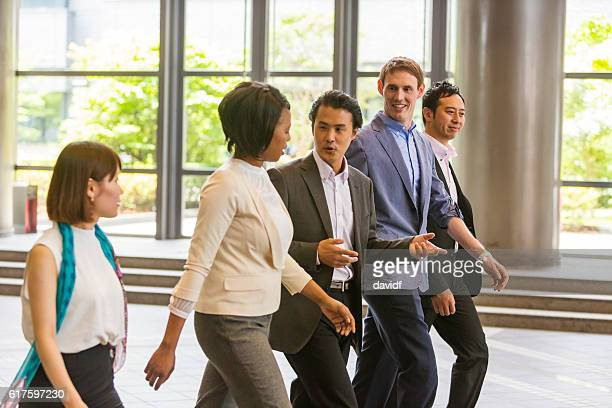 Mixed Race Group of Business People Walking Through Japanese Office