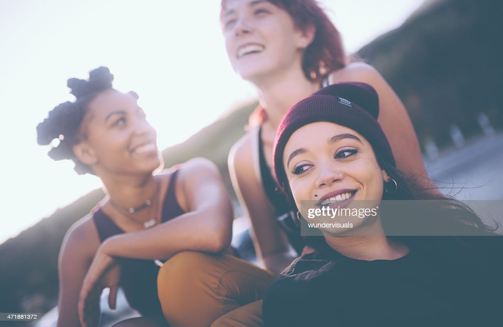Mixed race group of grunge girls hanging out together : Stock Photo