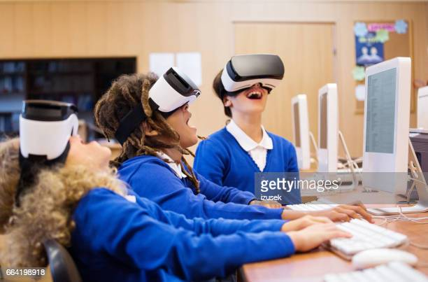 mixed race group of students using virtual reality goggles - digital native stock pictures, royalty-free photos & images