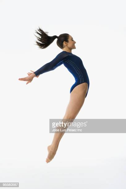 mixed race gymnast jumping in mid-air - gymnastics poses stock pictures, royalty-free photos & images