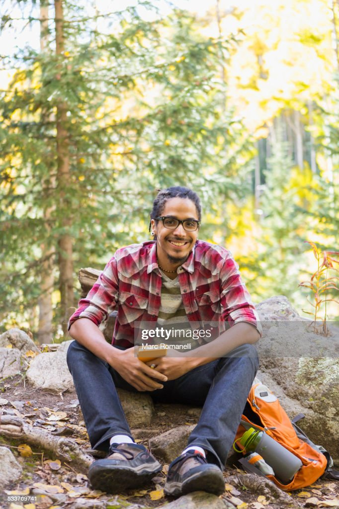 Mixed race hiker smiling in forest : Foto stock