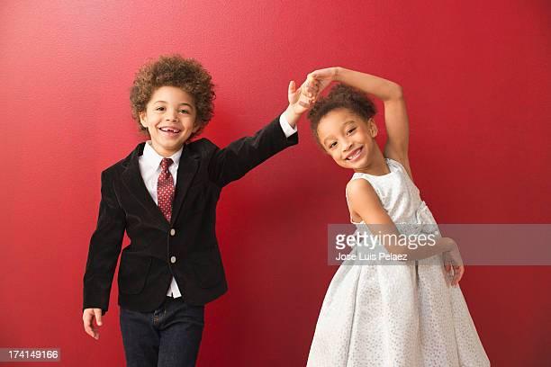 mixed race kids dancing - formal imagens e fotografias de stock