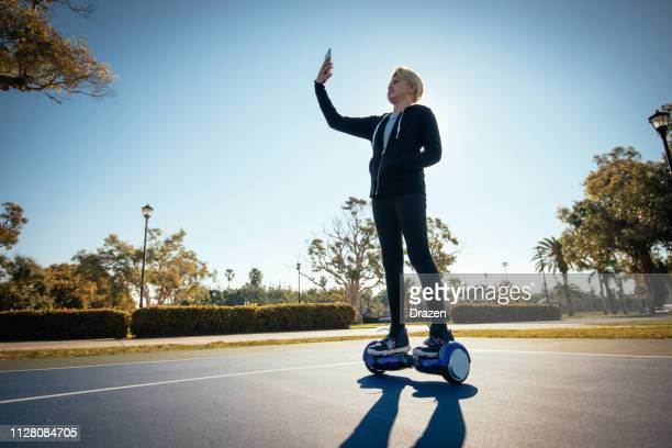 mixed race kids - latin teenager on the self balancing board - hoverboard stock pictures, royalty-free photos & images