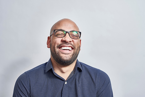 Mixed race male laughing with his head back - gettyimageskorea